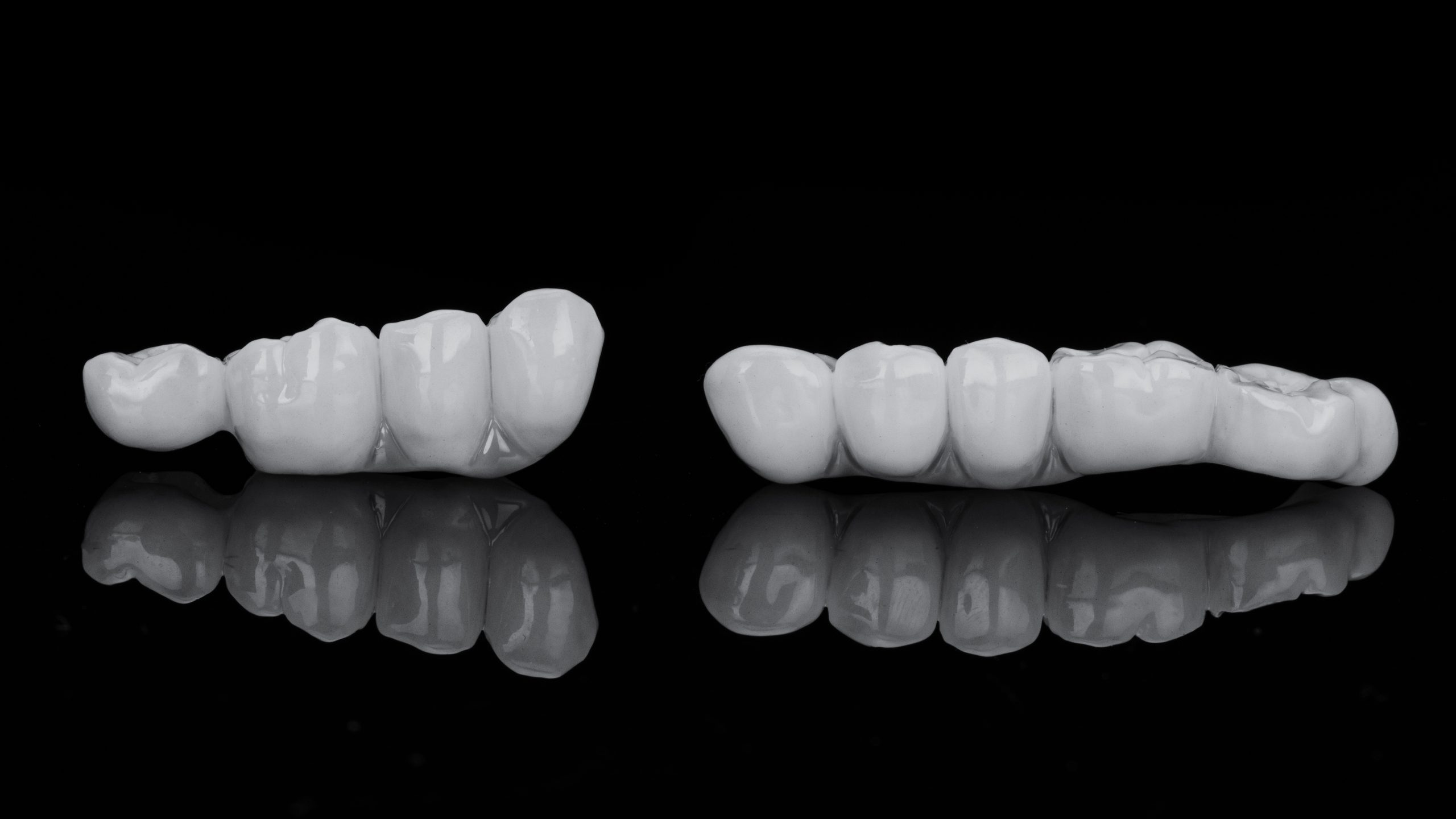 two dental bridges for the restoration of chewing teeth, photo in black and white style